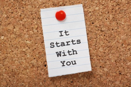 It Starts with You typed on paper on a cork notice board