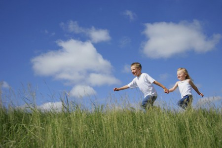 Boy and Girl Running in Tall Grass